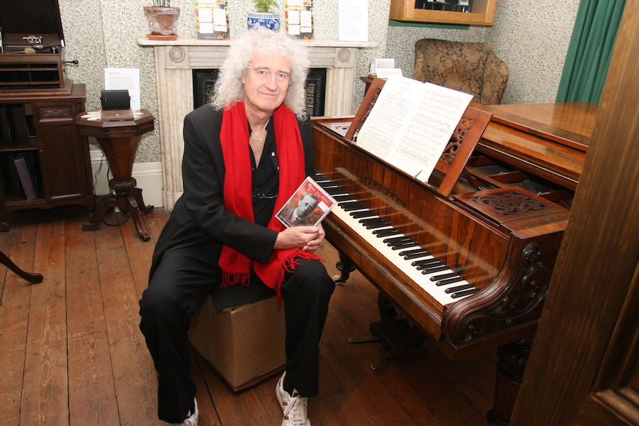 Brian May with Gustav Holst's piano